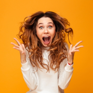 Young woman screaming with excitement
