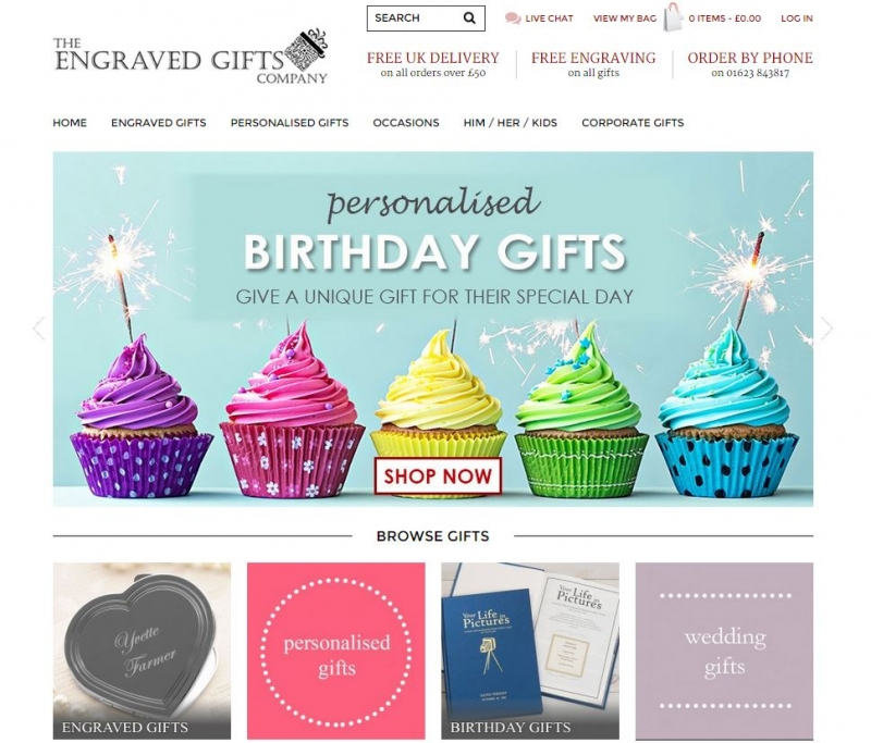 Cup cakes with lit sparklers feature on the home page of the web design.