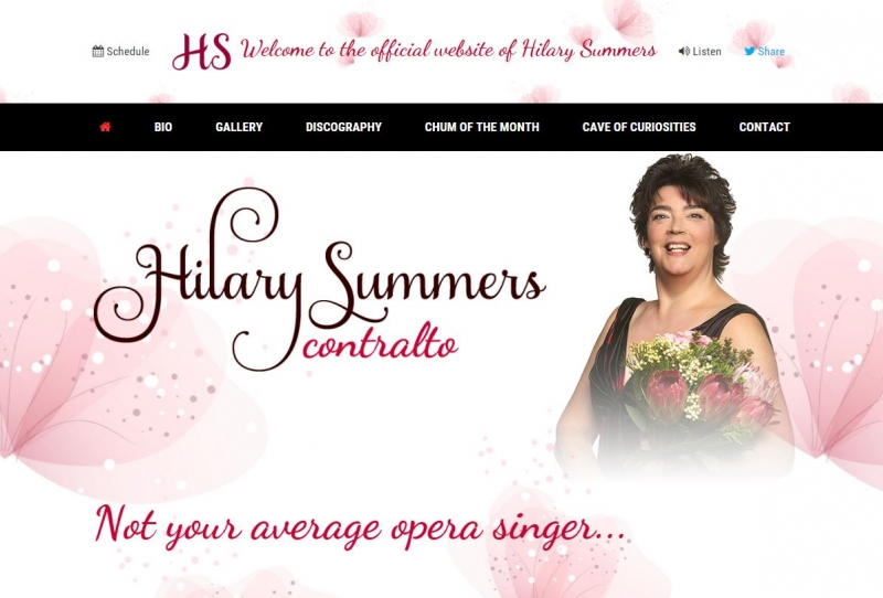 Hilary Summers against a white backdrop and pink feathery blossoms on website landing page.