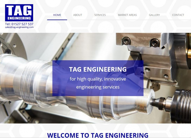 Engineering lathe creating a component on the landing page of the TAG website.