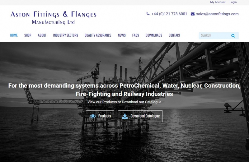 Large banner image of oil rig at sea in black and white on home page of website.