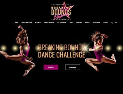 Two dancers leap high on the website home page