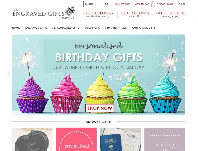 Five cup cakes with candles in different colours on the website home page.