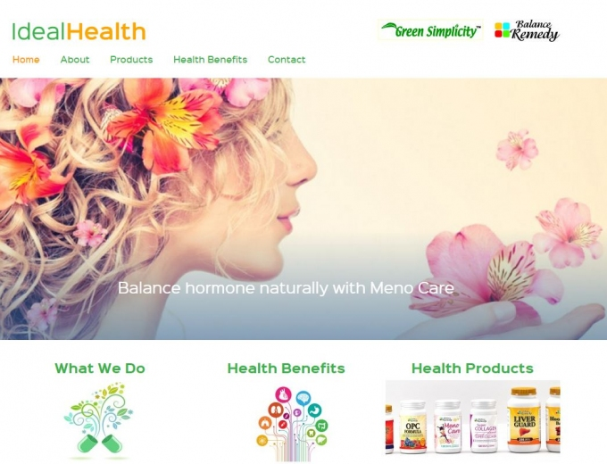 Beautiful woman with flowers in her hair blowing petals from her hand on website home page.