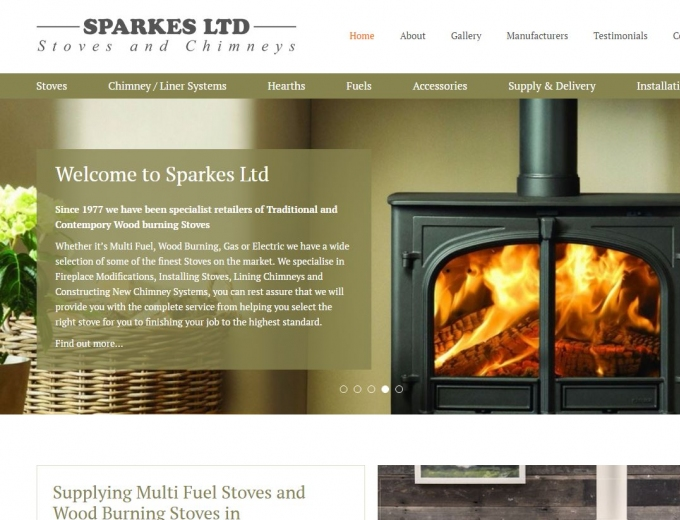 Roaring fire in a cast iron stove features on the Sparkes home page.