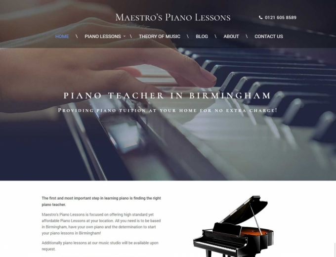 Close up of grand piano on website home page